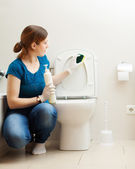 Young woman cleaning toilet bowl  — Stock Photo