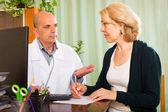 Male doctor talking with patient — Stock Photo