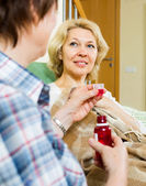 Retirement home employee offering mixture — Zdjęcie stockowe