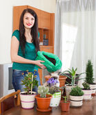 Happy girl transplanting flowers  — Stock Photo