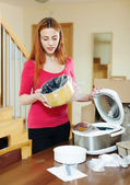 Young woman looking new multicooker — Photo