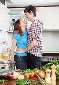 Loving couple flirting in kitchen — Stock Photo