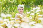 Two-year girl with camomile — Stock Photo