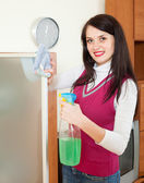 Smiling  girl cleaning  glass  — Stock Photo