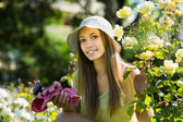 Young florist  in yard gardening — Stock Photo