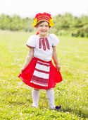 Happy girl in russian folk clothes — Stock Photo