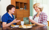 Smiling colleagues drinking tea — Stock Photo