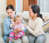 Woman comforting  adult daughter with toddler  — Stock Photo