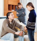 Mother and father together scolding  son   — Stock Photo