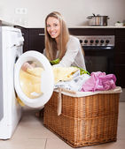 Woman with linen basket — Stock Photo