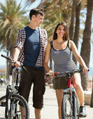 Man and woman with bicycles — Stock Photo