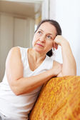Pensive mature woman in home — Stock Photo