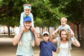 Happy family with three kids — Stock Photo