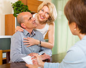 Mature couple filling questionnaire — Stock Photo