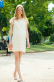 Pregnant woman walks in summer park — Stock Photo