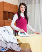 Woman ironing with iron — Stock Photo