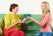 Adult daughter congratulating happy mother — Stock Photo