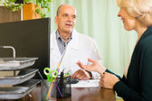 Doctor discussing with mature woman  — Stok fotoğraf