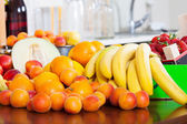 Fruits on kitchen table   — Stock Photo