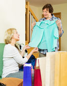 Pensioner bragging with new blouse — Stock Photo