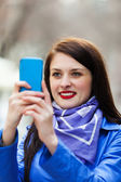Girl with smartphone photographing — Stock Photo