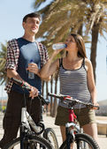 Sportive young people with bikes — Stock Photo