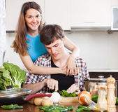 Happy man and pretty woman cooking — Stock Photo