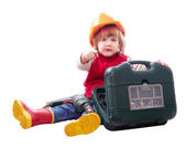 Child in hardhat with drill — Photo