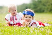 Smiling children in ukrainian folk clothes — Stock Photo