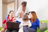 Happy family enjoys  with few laptops — Stock Photo