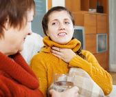 Woman caring for sick adult daughter — Stock Photo