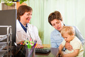 Doctor examining baby — Stock Photo