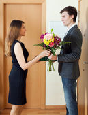 Wife takes flowers from husband — Stock Photo