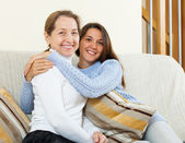 Daughter and mother on sofa — Stock Photo