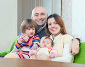 Happy man with wife and children — Stock Photo