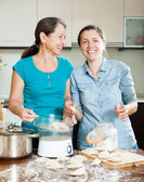 Happy women cooking  dumplings  — Stock Photo