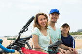 Parents and son with bicycles — Stock Photo