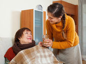 Daughter caring for unwell mother — Stock Photo