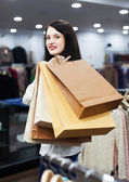 Ordinary woman buyer with shopping bags — Stock Photo
