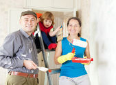 Happy family  makes repairs at home — Stock Photo