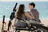 Smiling couple relaxing after cycling — Foto Stock