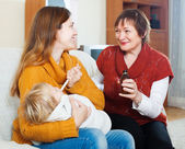 Women giving syrup to baby — Stock Photo