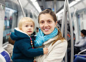 Woman with baby in subway train  — Stock Photo