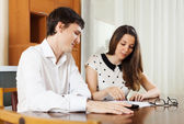 Young family with financial documents — Stock Photo