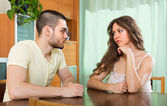 Serious young couple talking at home — Stockfoto