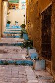 Narrow street in old european city  — Stock Photo