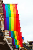 Rainbow flags on houses — Stock Photo