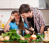 Young man and woman try food — Stock Photo