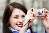 Female tourist with photocamera — Stock Photo