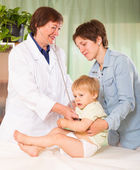 Pediatrician doctor examining baby girl — Stock Photo